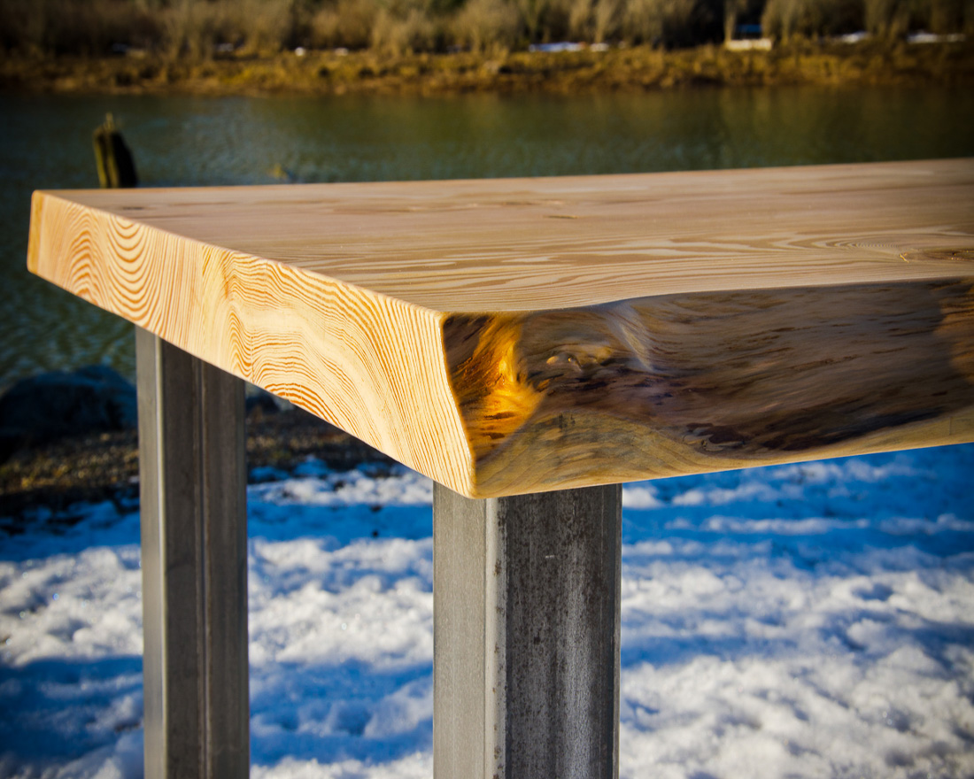 Live edge table and steel legs - custom furniture by Blueline Contracting